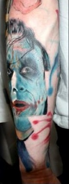 Blue Ink Joker Portrait Tattoo On Arm