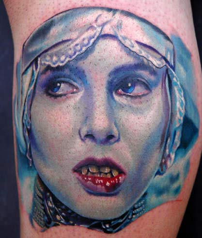 Blue Vampire Face Portrait Tattoo