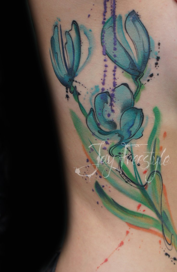 Blue Watercolor Tulips Tattoo On Ribs