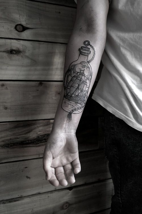 Boat In Ship Tattoo On Forearm