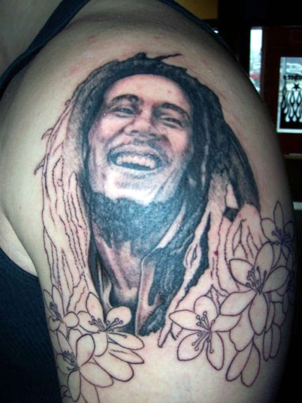 Bob Marley Portrait In Flower Tattoos On Shoulder