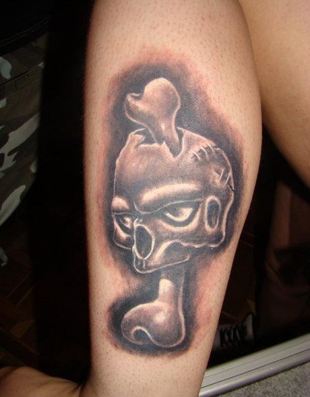 Bone Through Skull Portrait Tattoo
