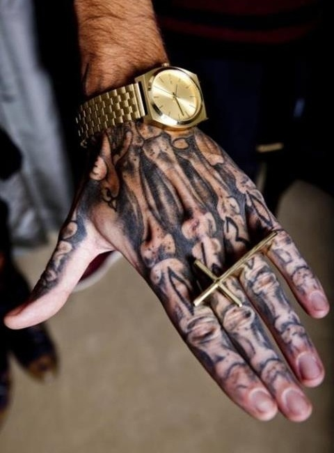 Bones Hand Tattoo And Golden Cross