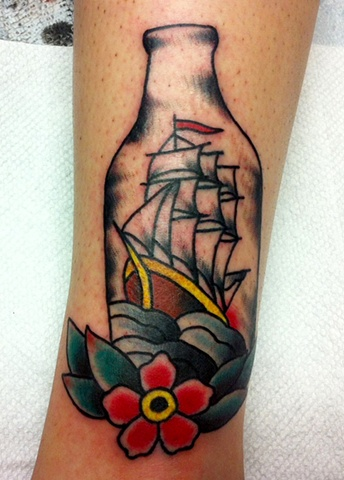 Bottle With Ship And Flower Tattoos