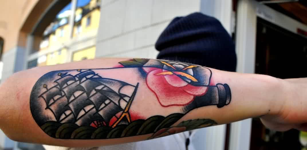 Bottle With Ship Tattoo On Arm