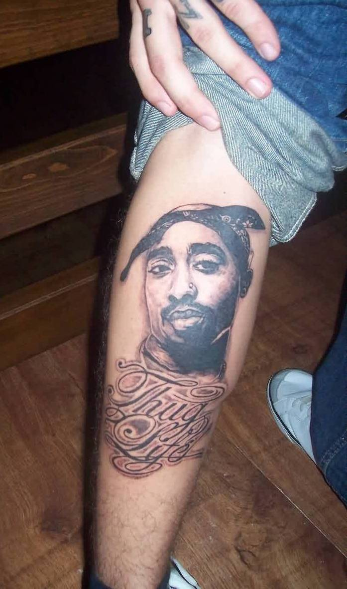 Boy Shows Off His 2 Pac Portrait Tattoo On Leg