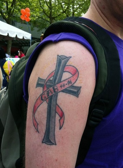 Breast Cancer Ribbon On Cross Tattoo On Biceps