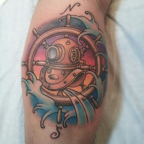 Brown Diving Helmet Wheel And Wave Tattoos