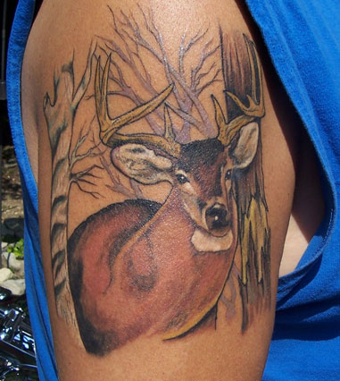 Brown Ink Animal Tattoo On Biceps