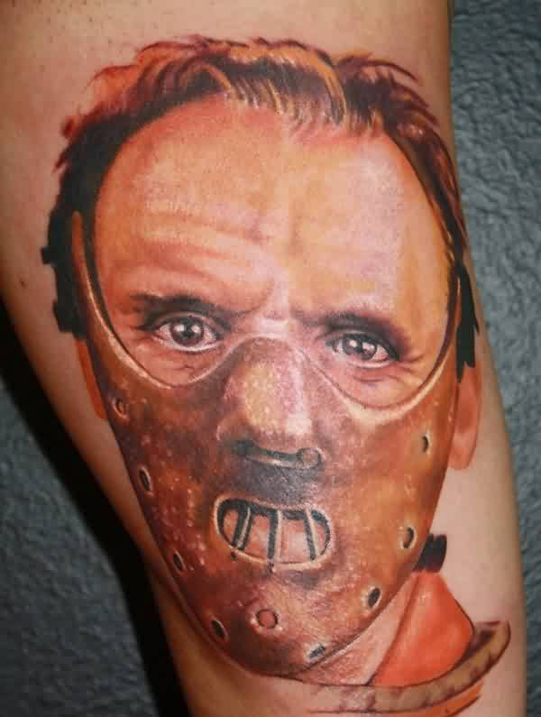 Brown Ink Hanibal Portrait Tattoo