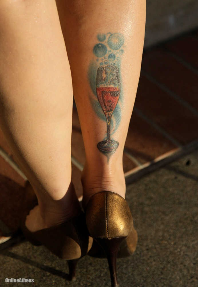 Bubbles And Wine Glass Tattoos On Right Leg