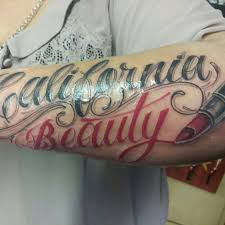 California Beauty Lipstick Tattoo On Arm