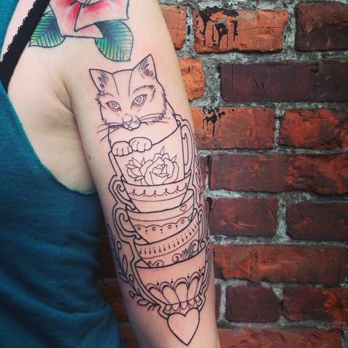 Cat In Cup Outline Tattoo On Arm