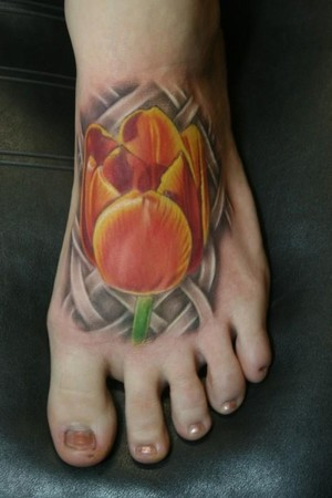 Celtic And Tulip Flower Tattoos On Foot