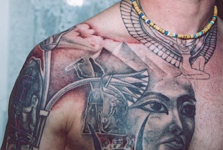 Clouds And Egyptian Pyramid Tattoos On Chest