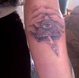Clouds And Grey Pyramid With Eye Tattoo On Arm