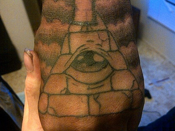 Clouds And Illuminati Eye Pyramid Tattoos On Hand