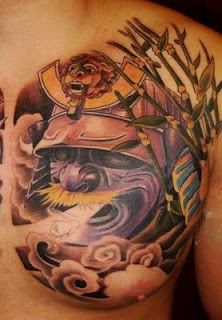 Clouds And Japanese Warrior Helmet Tattoos On Chest