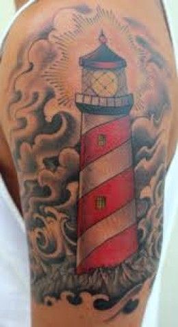 Clouds Waves And Lighthouse Tattoos On Biceps