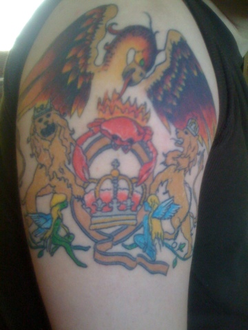 Color Ink Queen Band Tattoo On Shoulder