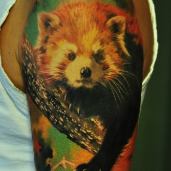 Colored Animal On Branch Tattoo