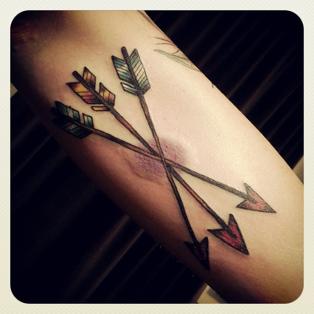 Colorful Arrows Tattoo On Arm