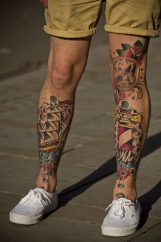 Colorful Ship Compass And Lighthouse Tattoos On Legs