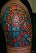 Colorful Stained Glass Jesus Tattoo On Biceps