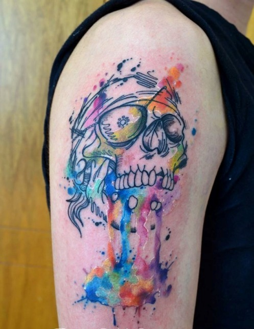 Cool Watercolor Skull Tattoo On Biceps