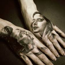 Couple Face Portrait Tattoos On Hands