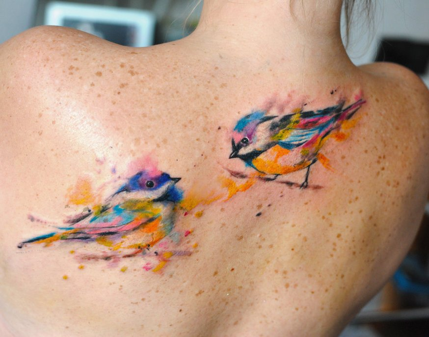 Couple Of Watercolor Bird Tattoo On Back