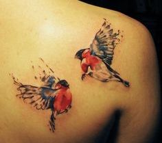 Couple Of Watercolor Bird Tattoos On Back Of Shoulder