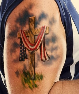 Cross With American Flag Tattoo On Biceps