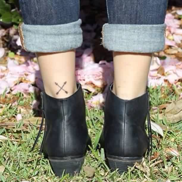 Crossed Arrow Tattoos On Left Leg