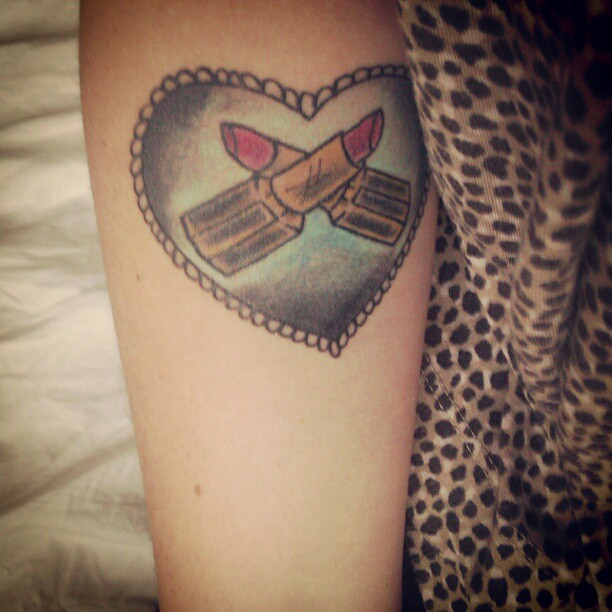 Crossed Lipstick In Rope Heart Tattoo