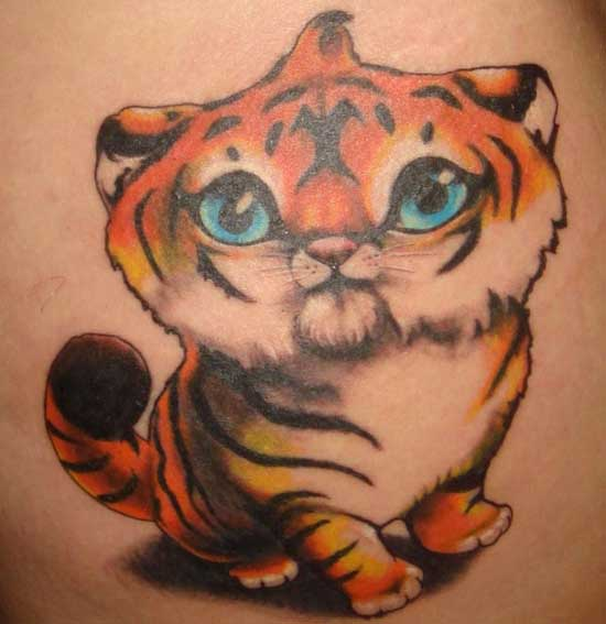 Cute Blue Eyed Animal Tattoo