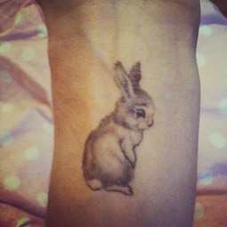 Cute Grey Animal Tattoo On Inner Wrist