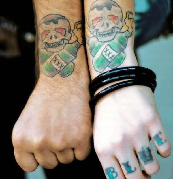 Cute Matching Skull And Bottle Tattoos On Wrist