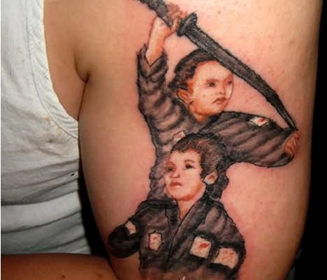Cute Warrior Portrait Tattoos On Muscles