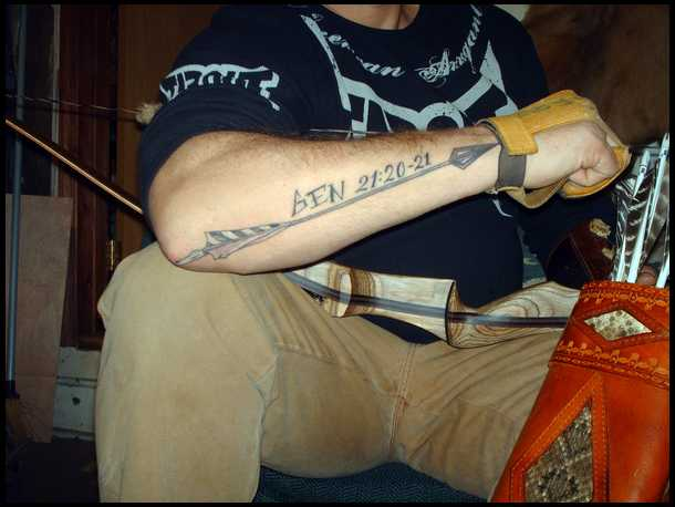 Date And Long Arrow Tattoo On Arm