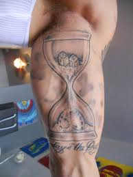 Dice In Hour Glass Tattoo On Muscles