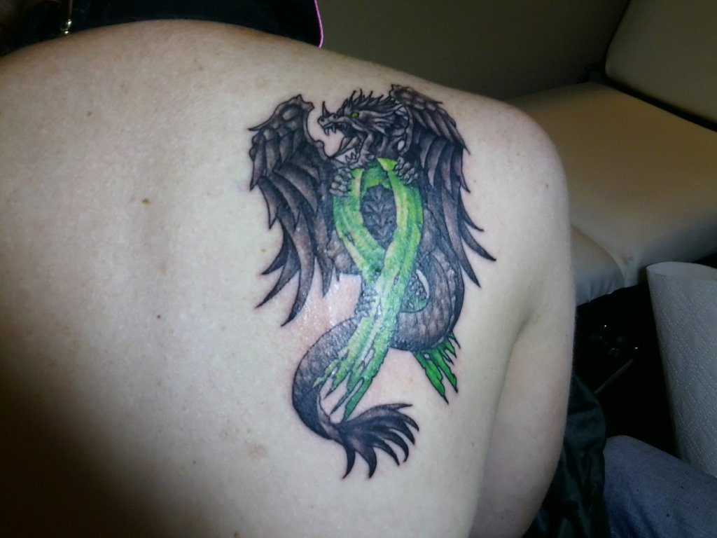 Dragon  With Green Cancer Ribbon Tattoo