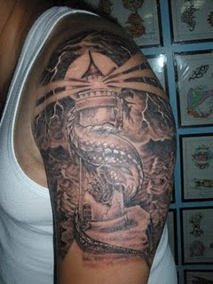 Dragon Wrap Lighthouse Tattoo On Biceps