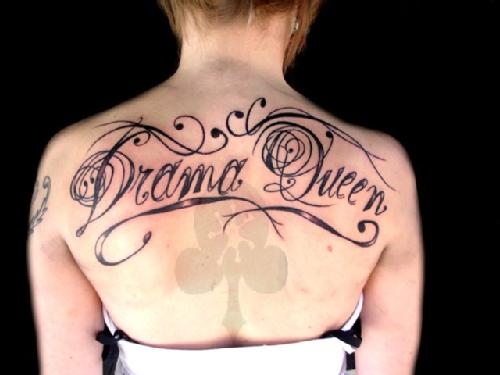 Drama Queen Lettering Tattoo On Upperback