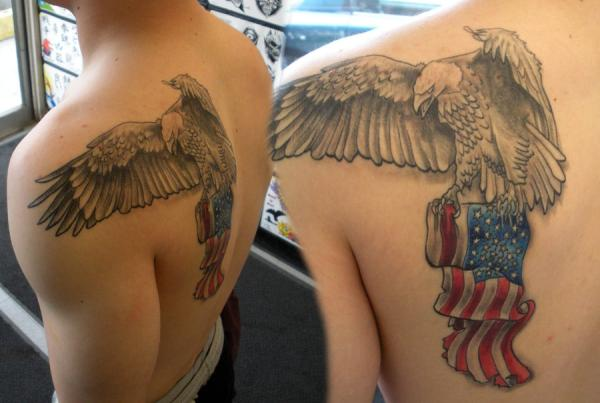 Eagle Carrying American Flag Tattoo