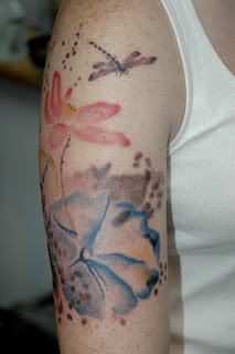 Elegant Watercolor Tattoos On Biceps