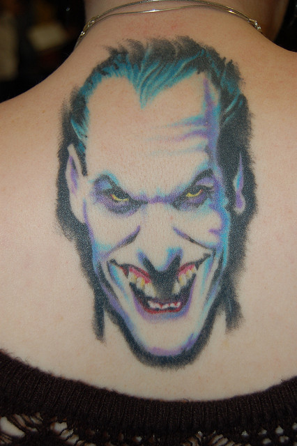 Evil Joker Portrait Tattoo On Upperback