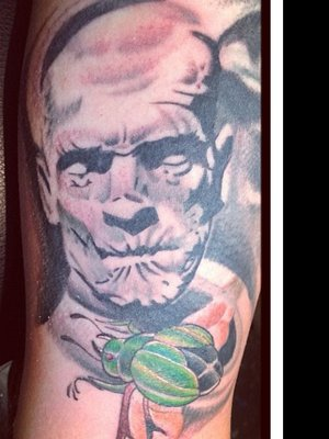 Evil Portrait And Green Beetle Tattoos