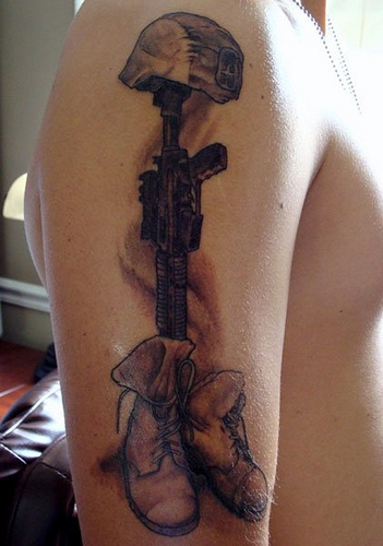 Fallen Soldier's Helmet Gun And Boot Tattoos On Biceps