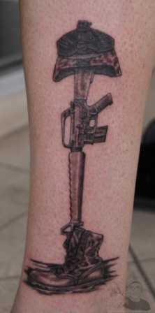 Fallen Soldier's Helmet Gun And Boot Tattoos